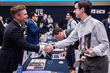 Student shaking hand with a representative at Law School Fair