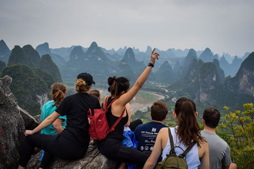 Global Bachelor's Program students sitting atop a mountain in China.